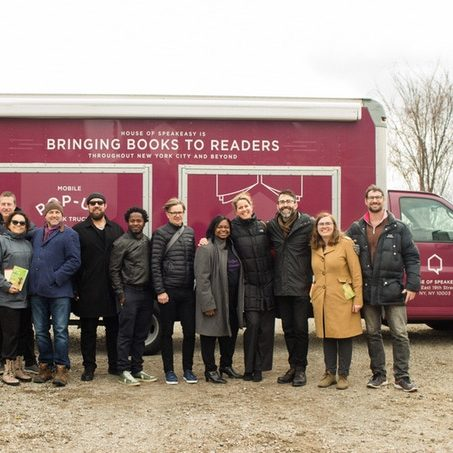 N4 and House of SpeakEasy team members stand in front of the book truck.